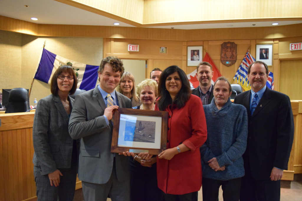 City of Kelowna Suburban & Rural Planning Manager Todd Cashin (holding plaque) shares the award with City Councillors.